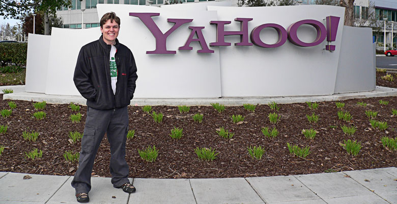 Daniel standing in front of the Yahoo! company logo